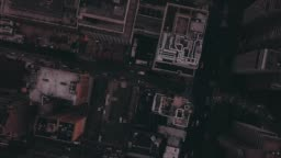 AERIAL: Birdsview Nighttime flight over Manhattan, New York City with glowing city lights in beautiful summer night (4K)