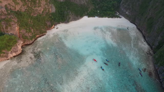 birdview flying into the maya bay at sunset - phi phi le stock videos & royalty-free footage