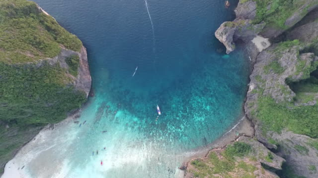 birdview of flying over the maya bay - phi phi le stock videos & royalty-free footage