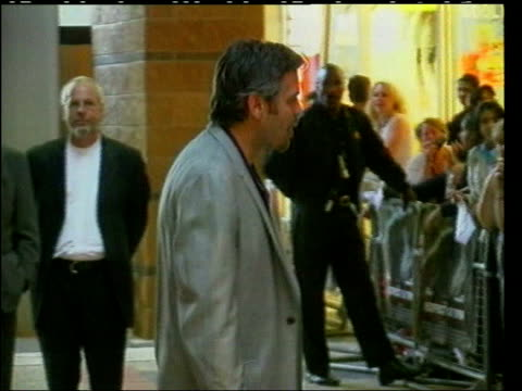 may in 1961 george clooney was born actor george clooney arriving for premiere of his film 'the perfect storm' and at press conference with costar... - george clooney stock videos and b-roll footage