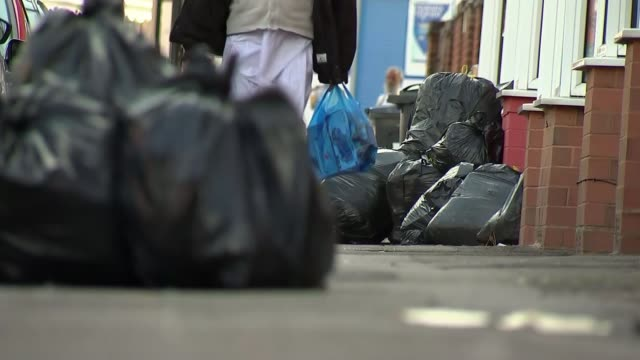 birmingham bins dispute resumes; england: birmingham: ext full wheelie bins and piles of black rubbish bags on the street black rubbish sacks with... - bin stock videos & royalty-free footage