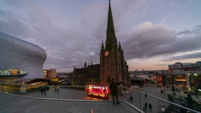 birmingham bull ring commercial area and st martin's cathedral, dusk to night time-lapse - birmingham england stock videos & royalty-free footage