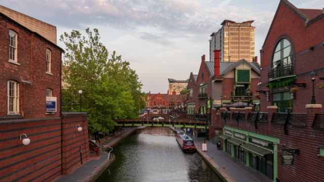 birmingham canal and restaurants, west midlands, uk - 4k time lapse (zoom-out) - west midlands stock videos & royalty-free footage