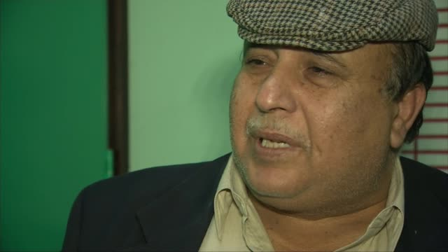 Father of taxi driver speaks of family's shock and grief ENGLAND Birmingham INT Ikhtiar Mohammed wiping tears from eyes