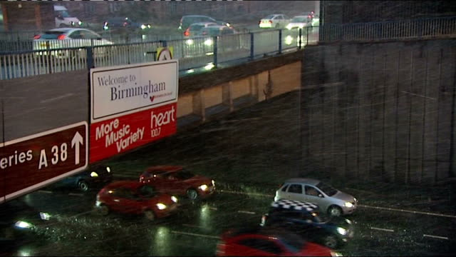 vídeos de stock, filmes e b-roll de cars driving under bridge in sleet lorry and cars along tracking shot following gritting lorry - chuva congelada