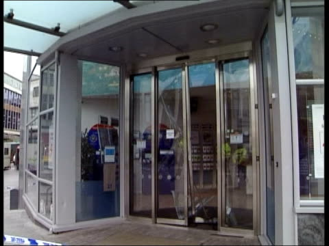 u'lay england birmingham nationwide offices where armed robbery occurred tilt down broken glass in door ms broken glass in door ms broken door seen... - itv late news stock-videos und b-roll-filmmaterial
