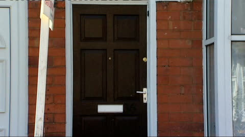 handsworth: ext general views terraced house reporter to camera - handsworth stock videos & royalty-free footage