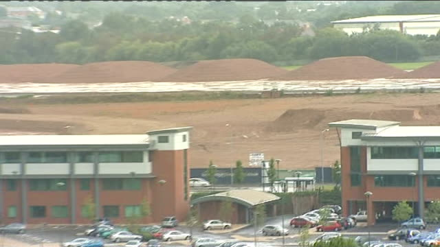 longbridge: ext high angle view of wasteland at site of former mg rover car plant at longbridge bert hill set-up shot with reporter / interview sot - longbridge stock videos & royalty-free footage
