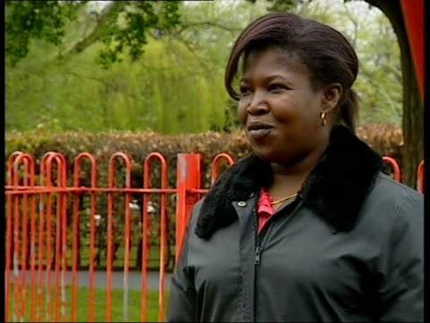 birmingham: longbridge: ext seq joy francis playing with daughter on swings in park joy francis interviewed sot - the way things are moving at work... - longbridge stock videos & royalty-free footage