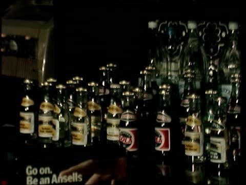 vídeos y material grabado en eventos de stock de pub with no beer; england: birmingham: gv exterior pub 'fox & goose': ditto: interior, barman with crate, places it on bar counter takes out bottle,... - birmingham condado de west midlands