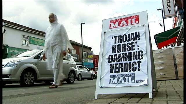 schools threatened with losing funding england birmingham alum rock ext 'trojan horse damning report' headline on birmingham mail newsstand... - burka stock videos and b-roll footage