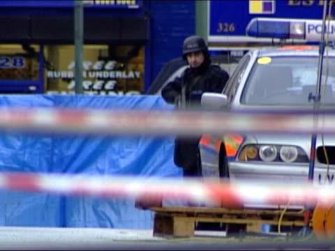 birmingham shootings/ new penalties lib england london hackney police marksman behind police car with rifle aimed - gun crime stock videos & royalty-free footage