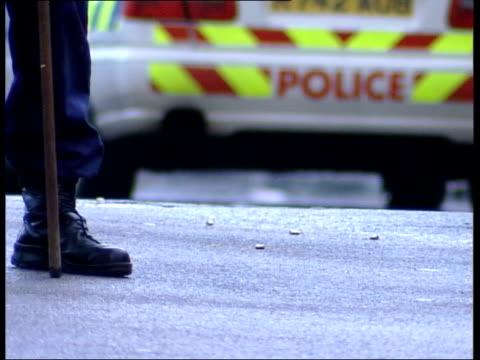 birmingham shootings/ new penalties lib police tape sealing off scene of shooting pull focus lbv police officers working at scene cms bullet cases... - gun crime stock videos & royalty-free footage