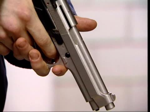 birmingham shootings/ new penalties lib handgun cocked and trigger pulled cs handgun held cs handgun aimed and trigger pulled - gun crime stock videos & royalty-free footage