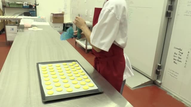 stockvideo's en b-roll-footage met a birmingham woman who set up social enterprise and baking business miss macaroon is among the select few to be invited to the imminent royal wedding... - birmingham engeland