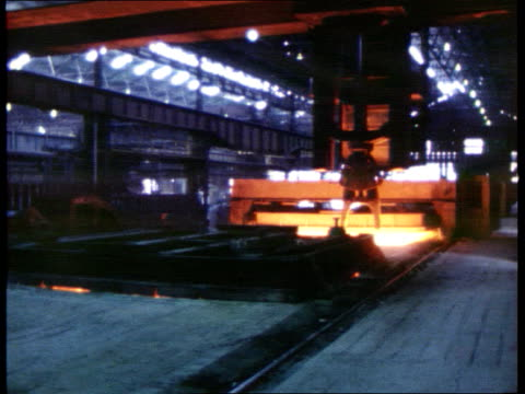 Birth defects link LIB ENGLAND Northamptonshire Corby INT Steel bar being moved alongminside steel works GV Steel works