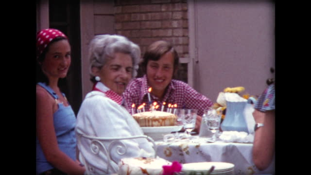 vídeos de stock, filmes e b-roll de 1974 birthday cake and bicycle present - home movie