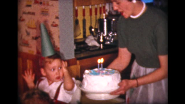 1958 birthday cake for two year old - five people stock-videos und b-roll-filmmaterial
