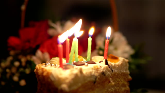 Birthday Cake with burning candles in slow motion 4k