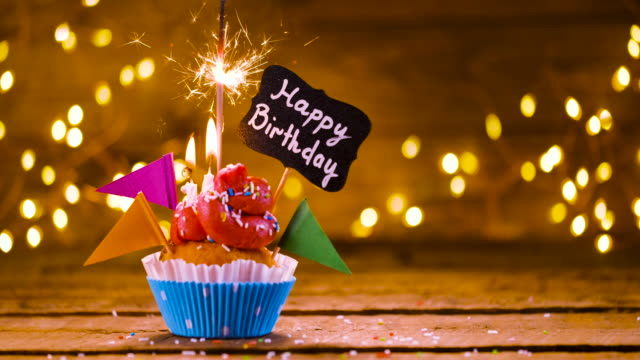 birthday cupcake with text and sparkler - birthday gift stock videos & royalty-free footage