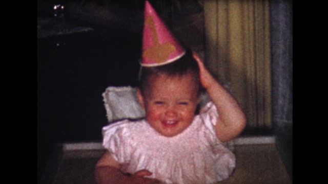 vídeos de stock e filmes b-roll de 1958 birthday girl in high chair - film moving image