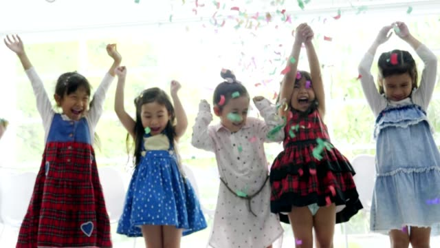 birthday party children with colored confetti - birthday stock videos & royalty-free footage