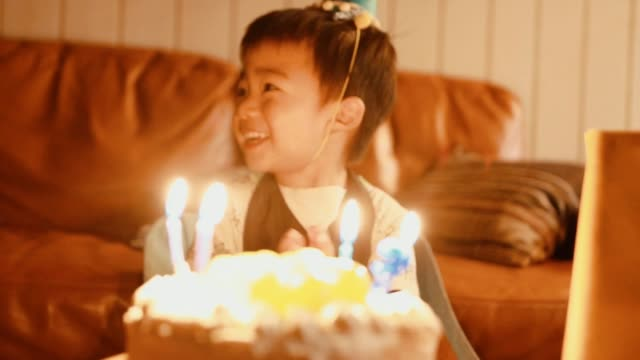 birthday party for asian little boy - birthday candle stock videos & royalty-free footage