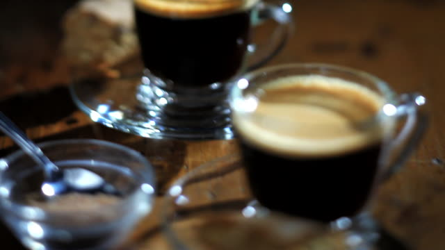 biscotti accompanies mugs of coffee on a table. - sweet food stock videos & royalty-free footage