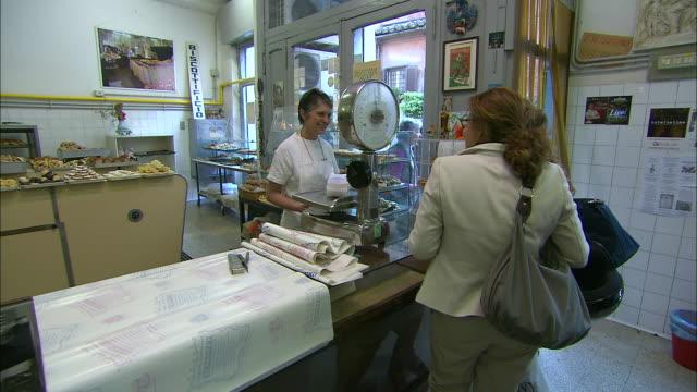 Biscotti shop transaction between women