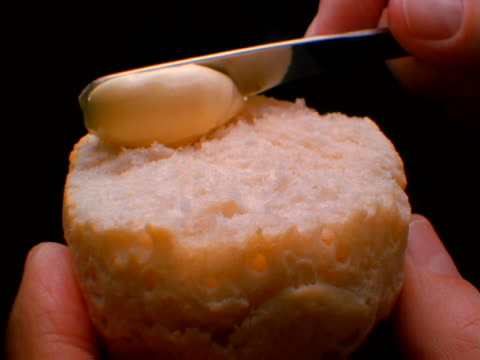 a biscuit being spread with butter - biscuit stock videos & royalty-free footage