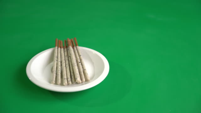 biscuit stick with cookie and cream on green screen