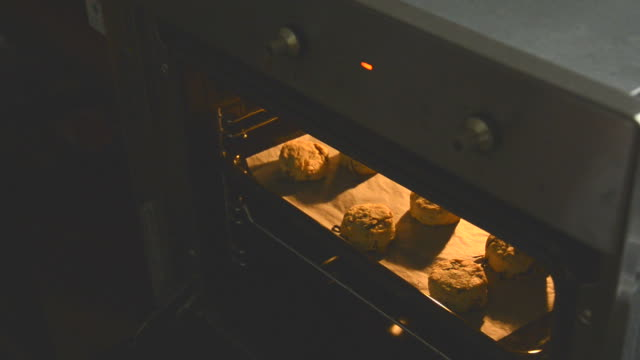 biscuits in the oven - oven mitt stock videos and b-roll footage