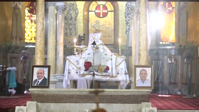 Bishop Daniel the deputy of Egyptian Coptic Christian religious leader Pope Tawadros II leads a mourning ceremony attended by relatives and friends...