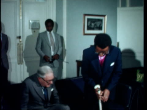 stockvideo's en b-roll-footage met london embassy of zimbabwe rhodesia james callaghan mp and abel muzorewa into room and sit down foreign office ext pan muzorewa rl no 10 int ms... - peter carington