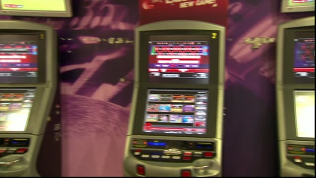 bishop of st albans calls for government to tighten laws on gambling machines r20121311 / ladbrokes int fixed odds betting terminals in bookmaker's... - 可能性点の映像素材/bロール