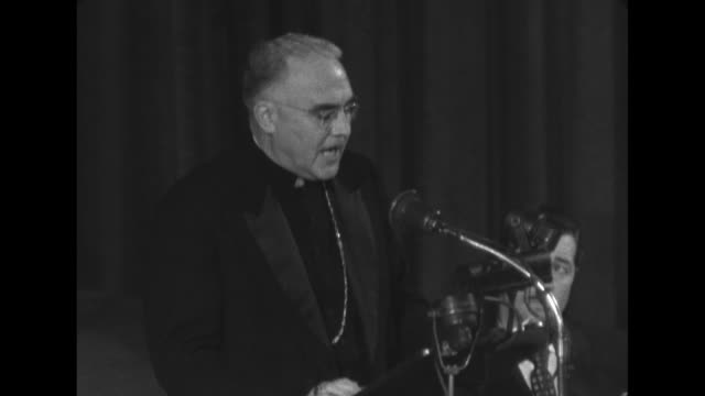 bishop william a. scully walks across dais to microphone with standing ovation from the crowd and celebrities present / sot scully ñaware of the... - catholicism stock videos & royalty-free footage