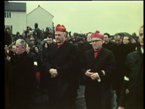 bishops lead funeral procession for victims of bloody sunday shootings creggan estate londonderry 2 feb 72 - northern ireland stock videos & royalty-free footage