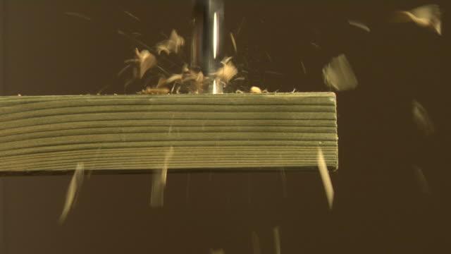 cu bit drilling through wood, london, england - sfondo marrone video stock e b–roll