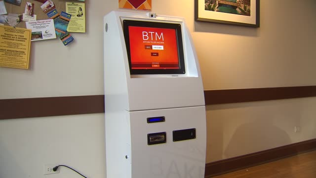 bitcoin atm at cassava restaurant on n clark street in chicago illinois on july 28 2014 - bitcoin stock videos & royalty-free footage