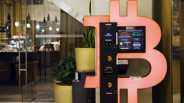bitcoin atm machine in mall for cryptocurrency exchange - cryptocurrency stock videos & royalty-free footage