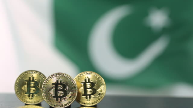 bitcoin cryptocurrency coin with the national flag of pakistan - currency symbol stock videos & royalty-free footage