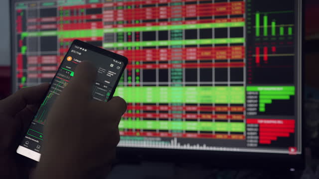 bitcoin is a worldwide cryptocurrency and digital payment system. businessman reading financial news. stock market, trading online, trader working with smartphone on stock market trading floor. - market trader stock videos & royalty-free footage