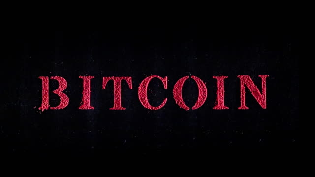 vídeos de stock e filmes b-roll de bitcoin written in red exploding text - david ewing