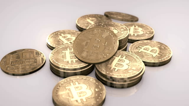 bitcoins in a pile - bitcoin stock videos & royalty-free footage