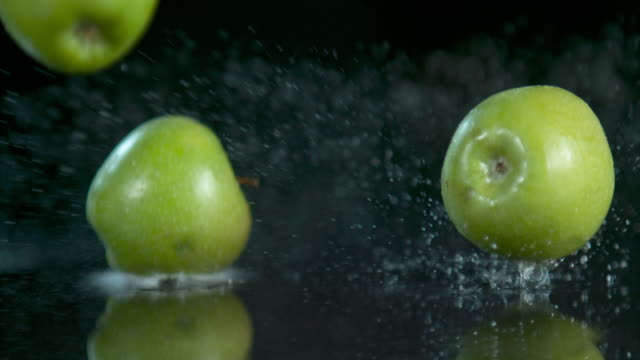 bite and let the explosion of flavor happen - apple fruit stock videos & royalty-free footage