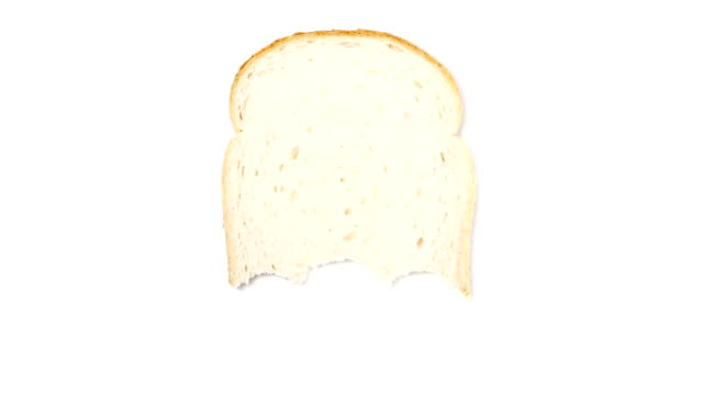 Bites being eaten from a slice of bread, white background