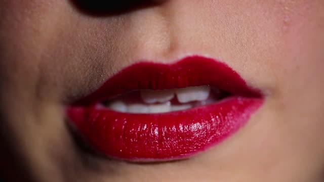 Biting red lips