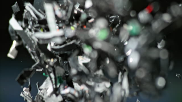 slo mo bits of shredded plastic falling down - recycling stock videos & royalty-free footage