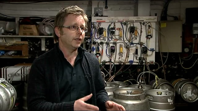 'bitter' split opens up in the pub industry over parliament vote england int paul crossman tapping barrels of beer crossman along in pub cellar... - publican stock videos & royalty-free footage
