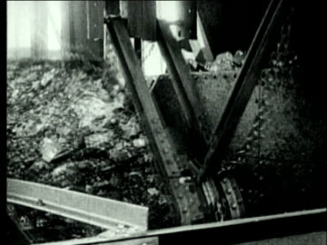 1927 b/w ms bituminous coal being unloaded from container for sorting/ pennsylvania, usa - steel stock videos & royalty-free footage